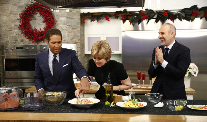 """This image released by NBC shows, from left, guest hosts, Bryant Gumbel and Jane Pauley, with host Matt Lauer during a cooking segment on NBC News' """"Today"""" show, Monday, Dec. 30, 2013 in New York. Gumbel and Pauley, who worked together on """"Today"""" from 1982 to 1989, joined Matt Lauer to co-host on Monday, filling in for Savannah Guthrie and Natalie Morales who were off. (AP Photo/NBC, Peter Kramer)"""