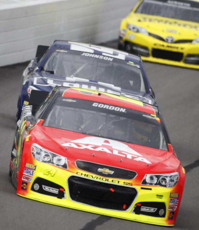 Driver Jeff Gordon (24) leads Jimmie Johnson (48) through turn one during a NASCAR Sprint Cup series auto race at Kansas Speedway in Kansas City, Kan., Sunday, Oct. 6, 2013. (AP Photo/Colin E. Braley)