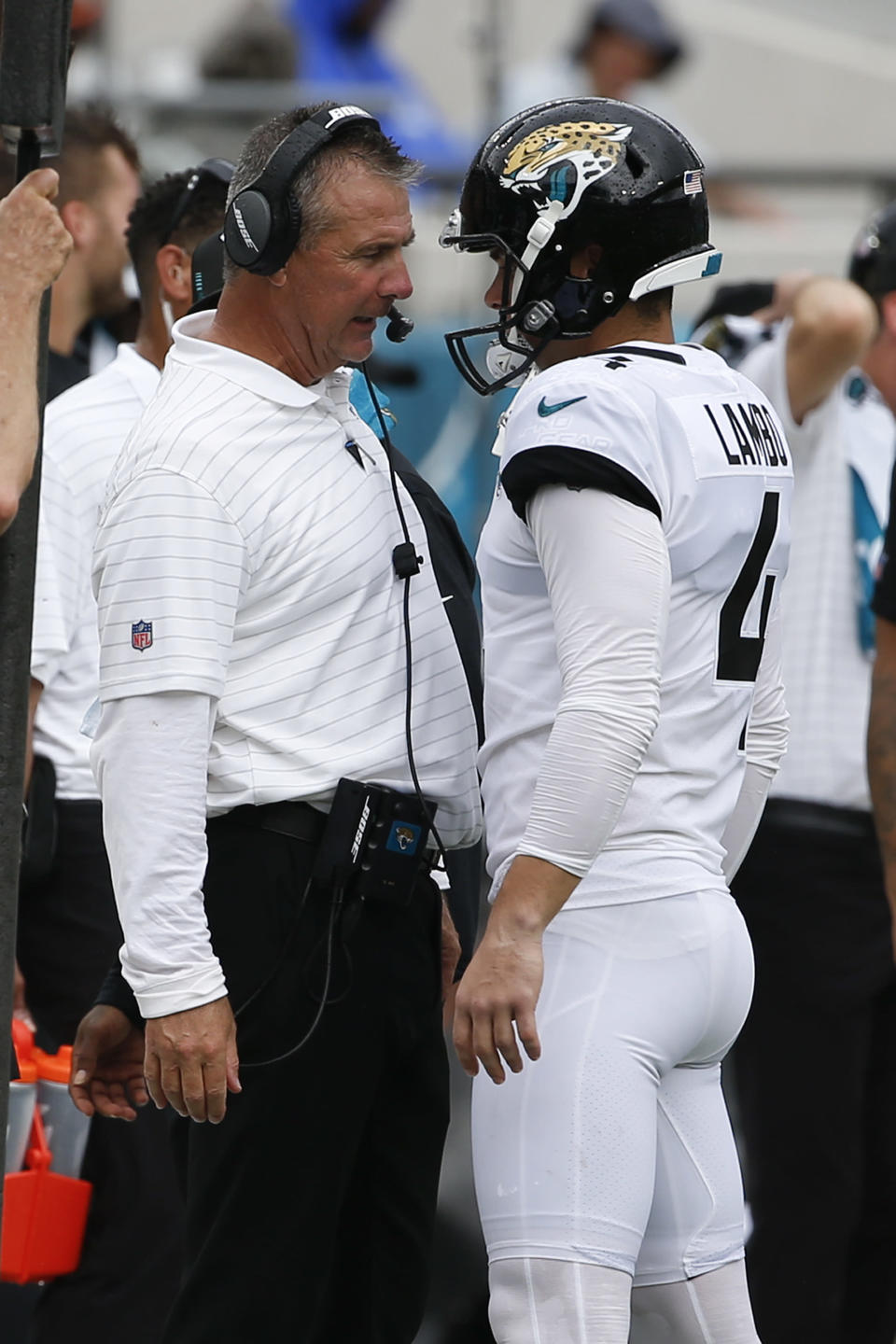 Jacksonville Jaguars head coach Urban Meyer, left, talks with place kicker Josh Lambo after Lambo missed his second field goal against the Denver Broncos during the first half of an NFL football game, Sunday, Sept. 19, 2021, in Jacksonville, Fla. (AP Photo/Stephen B. Morton)