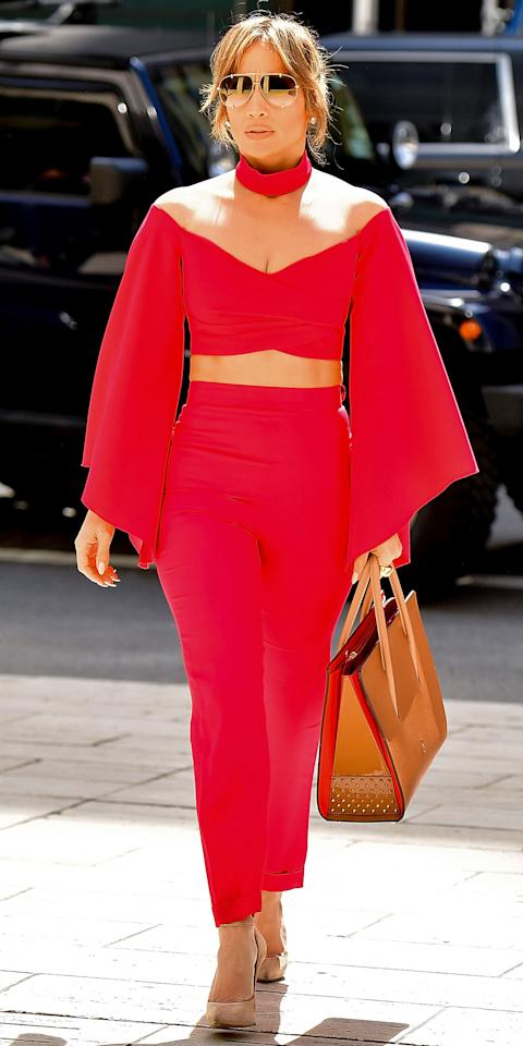 "<p>The singer looked red-hot in N.Y.C. on Monday in an off-the-shoulder Balmain crop top ($2,835; <a rel=""nofollow"" href=""https://click.linksynergy.com/fs-bin/click?id=93xLBvPhAeE&subid=0&offerid=254155.1&type=10&tmpid=6894&RD_PARM1=https%3A%2F%2Fwww.net-a-porter.com%2Fus%2Fen%2Fproduct%2F856261%2FBalmain%2Fcropped-mesh-paneled-crepe-top&u1=IS,CEL,GAL,JenniferLopezandAlexRodriguez%27sCutestCoupleMoments,bahouo,201704,I"">net-a-porter.com</a>), matching high-waist pants, nude Casadei pumps ($750; <a rel=""nofollow"" href=""http://www.casadei.com/en/shoes/pumps/blade-pandora-1F090D125TT70495H.html?cgid=shoes-pumps#start=39"">casadei.com</a>), Dita sunglasses, and her favorite red-accented Christian Louboutin tote ($2,490; <a rel=""nofollow"" href=""https://click.linksynergy.com/fs-bin/click?id=93xLBvPhAeE&subid=0&offerid=483151.1&type=10&tmpid=5462&RD_PARM1=http%253A%252F%252Fwww.neimanmarcus.com%252FChristian-Louboutin-Paloma-Large-Triple-Gusset-Tote-Bag-Beige%252Fprod192400239%252Fp.prod%253Ficid%253D%2526searchType%253DMAIN%2526rte%253D%25252Fsearch.jsp%25253Ffrom%25253DbrSearch%252526request_type%25253Dsearch%252526search_type%25253Dkeyword%252526q%25253DPaloma%252BLarge%252BTriple-Gusset%252BTote%252BBag%25252C%252BBeige%2526eItemId%253Dprod192400239%2526cmCat%253Dsearch%2526tc%253D2%2526currentItemCount%253D1%2526q%253DPaloma%252BLarge%252BTriple-Gusset%252BTote%252BBag%25252C%252BBeige%2526searchURL%253D%252Fsearch.jsp%25253Ffrom%25253DbrSearch%252526start%25253D0%252526rows%25253D30%252526q%25253DPaloma%252BLarge%252BTriple-Gusset%252BTote%252BBag%25252C%252BBeige%252526l%25253DPaloma%252BLarge%252BTriple-Gusset%252BTote%252BBag%25252C%252BBeige%252526request_type%25253Dsearch%252526search_type%25253Dkeyword&LSNSUBSITE=LSNSUBSITE&u1=IS,CEL,GAL,JenniferLopezandAlexRodriguez%27sCutestCoupleMoments,bahouo,201704,I"">neimanmarcus.com</a>).</p>"