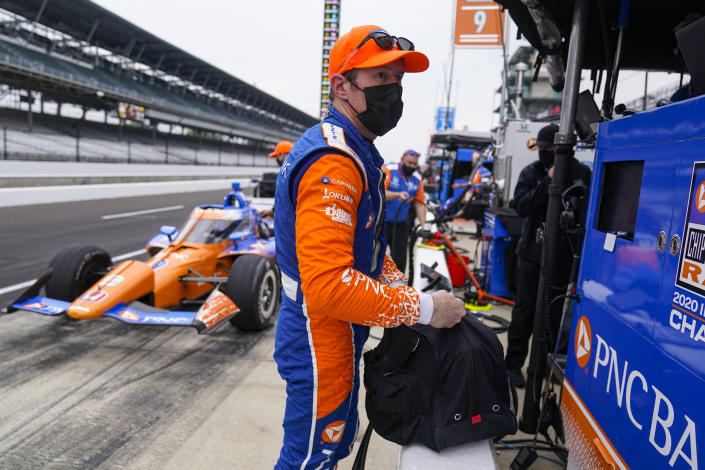 Scott Dixon, of New Zealand, bags up his helmet during practice for the Indianapolis 500 auto race at Indianapolis Motor Speedway in Indianapolis, Tuesday, May 18, 2021. (AP Photo/Michael Conroy)
