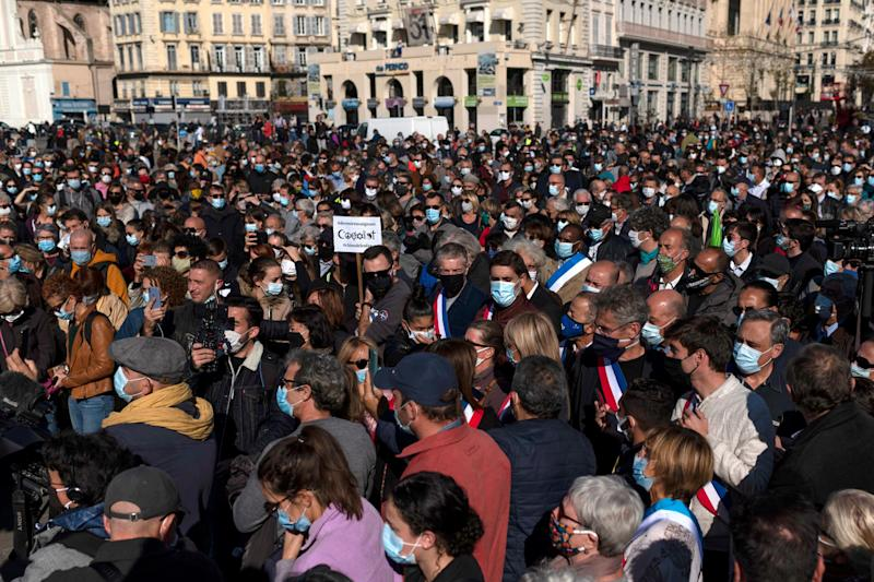 Crowds, clad in masks, joined in solidarity with Mr Paty (AFP via Getty Images)