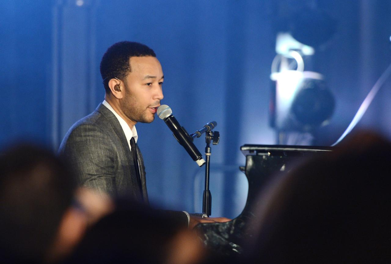WASHINGTON, DC - JANUARY 19:  Recording artist, actor John Legend performs at the Inaugural Youth Ball hosted by OurTime.org on January 19, 2013 in Washington, United States.  (Photo by Stephen Lovekin/Getty Images for OurTime.org)