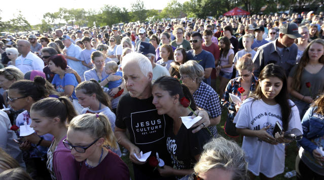 <p>Mourners gather during a prayer vigil following a shooting at Santa Fe High School in Santa Fe, Texas, on Friday, May 18, 2018. Seventeen-year-old Dimitrios Pagourtzis is charged with capital murder in the shooting rampage. A judge denied him bond at a court hearing Friday evening. (Photo: David J. Phillip/AP) </p>