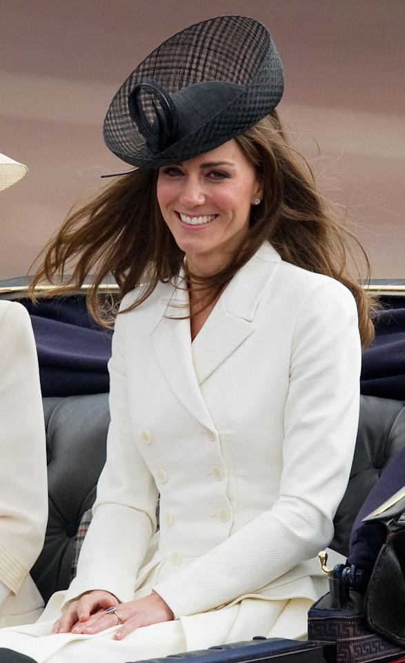 <p>Unlike Camilla, who kept her whole look light, the Duchess accessorised with a black hat to create this chic monochrome situation.</p>