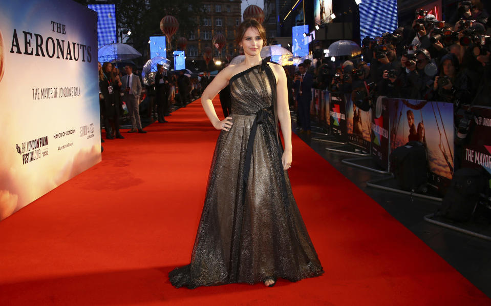 """FILE - Felicity Jones arrives at the premiere of """"The Aeronauts"""" during the London Film Festival, in central London, on Oct. 7, 2019. Jones turns 38 on Oct. 17. (Photo by Joel C Ryan/Invision/AP, File)"""
