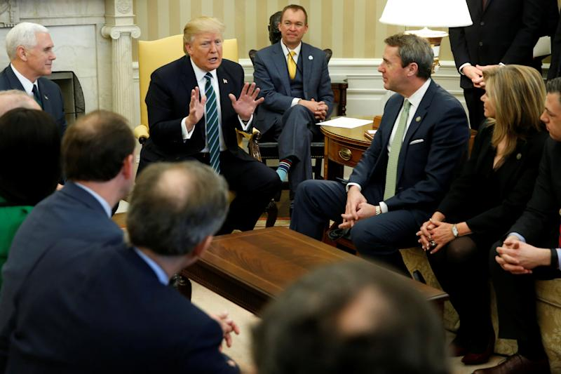 U.S. President Donald Trump, Vice President Mike Pence and Office of Management and Budget (OMB) Director Mick Mulvaney meet with U.S. Representative Mark Walker (R-NC) and members of the Republican Study Committee at the White House in Washington, U.S. March 17, 2017. REUTERS/Jonathan Ernst