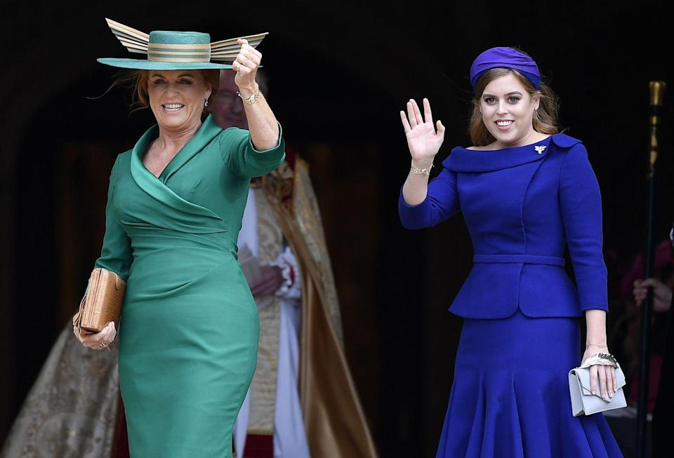 <p>Sarah Ferguson, the mother of the bride, chose a dramatic green and gold hat to complete her wedding day look.</p>
