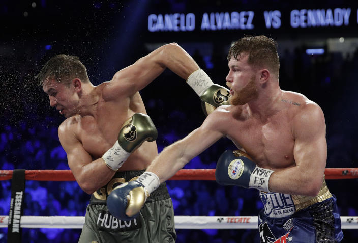 Gennady Golovkin (L) took issue with Canelo Alvarez's physique during their September fight. (AP)