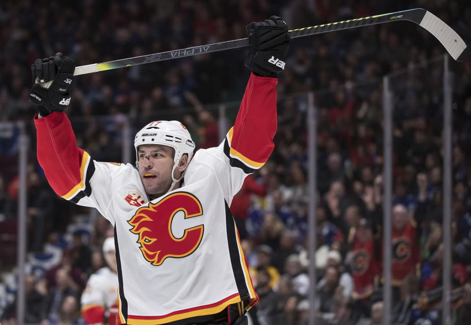 Calgary Flames' Milan Lucic celebrates his goal against the Vancouver Canucks during the third period of an NHL hockey game Saturday, Feb. 8, 2020, in Vancouver, British Columbia. (Darryl Dyck/The Canadian Press via AP)