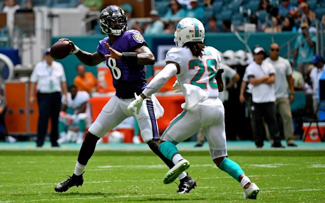 Baltimore Ravens quarterback Lamar Jackson impressed with his arm against the Miami Dolphins - USA TODAY Sports