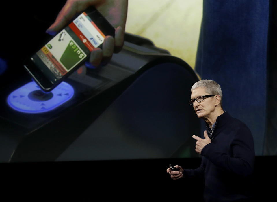 FILE - In this Thursday, Oct. 27, 2016, file photo, Apple CEO Tim Cook speaks during an announcement of new products, in Cupertino, Calif. Technology leaders are about to come face-to-face with President-elect Donald Trump after fiercely opposing his candidacy, fearful that he would stifle innovation, curb the hiring of computer-savvy immigrants and infringe on consumers' digital privacy. On Wednesday, Dec. 14, 2016, Silicon Valley luminaries and other technology leaders are headed to Trump Tower in New York to make their peace, or press their case, with Trump and his advisers. Cook is one of the CEOs expected to attend. (AP Photo/Marcio Jose Sanchez, File)