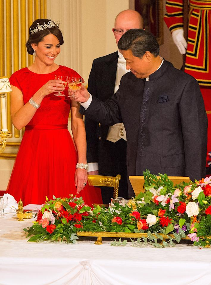 <p>Kate wore the Lotus Flower tiara for the second time, to her first State Dinner in 2015, with Chinese President Xi Jinping. She paid tribute to her guests and their national flag with a red bespoke gown from Jenny Packham (Getty) </p>