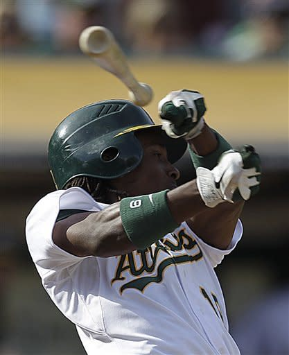 Oakland Athletics' Jemile Weeks loses his grip on his bat after swinging at a pitch from Baltimore Orioles' Darren O'Day in the eighth inning of a baseball game on Sunday, Sept. 16, 2012, in Oakland, Calif. (AP Photo/Ben Margot)