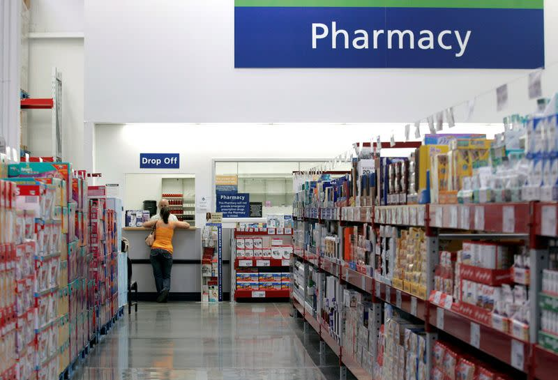 FILE PHOTO: A customer leans against the pharmacy counter at a Sam's Club store in Bentonville