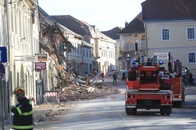 Firefighters arrive after an earthquake in Petrinja