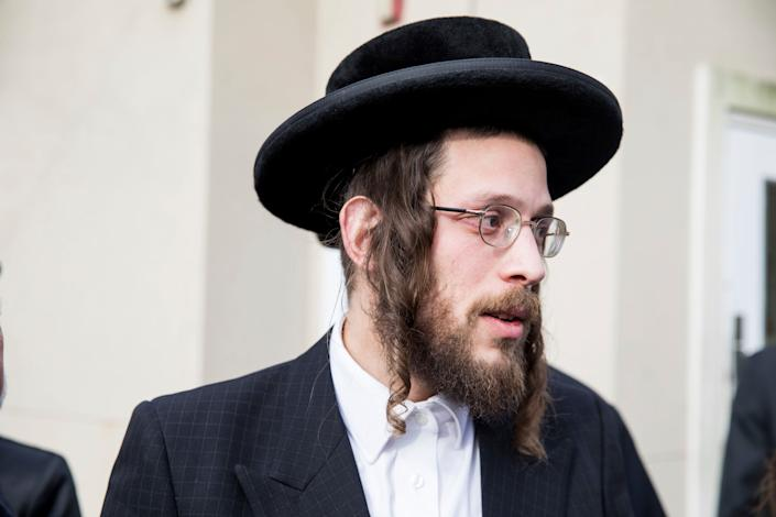 Josef Gluck talks to members of the media about how he obstructed the attacker Saturday night at a rabbi's home. (Photo: ASSOCIATED PRESS)