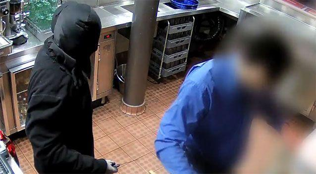 The robber wore black lycra hiding his face with a black jacket and black trousers. Photo: ACT Policing