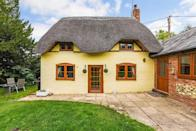 """<p>With a pretty yellow exterior and thatched roof, this charming cottage for sale in Hampshire is the absolute dream. Perfect for those looking to escape to the country, it has three bedrooms, a log-burning stove, refitted kitchen and glorious <a href=""""https://www.countryliving.com/uk/homes-interiors/gardens/a35277478/how-make-garden-more-private/"""" rel=""""nofollow noopener"""" target=""""_blank"""" data-ylk=""""slk:gardens"""" class=""""link rapid-noclick-resp"""">gardens</a>. </p><p><a href=""""https://www.zoopla.co.uk/for-sale/details/57528545"""" rel=""""nofollow noopener"""" target=""""_blank"""" data-ylk=""""slk:This cottage is currently on the market with Graham & Co via Zoopla"""" class=""""link rapid-noclick-resp"""">This cottage is currently on the market with Graham & Co via Zoopla</a>. </p>"""