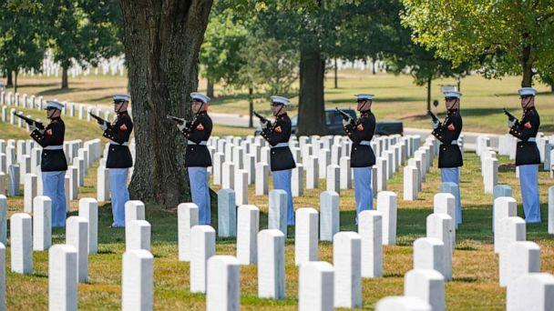 PHOTO: A firing party from the Marine Barracks in Washington fires volleys as part of military funeral honors for U.S. Marine Corps. Sgt. Meredith Keirn in Arlington National Cemetery in Arlington, Va., Aug. 8, 2019. (Elizabeth Fraser/U.S. Army)