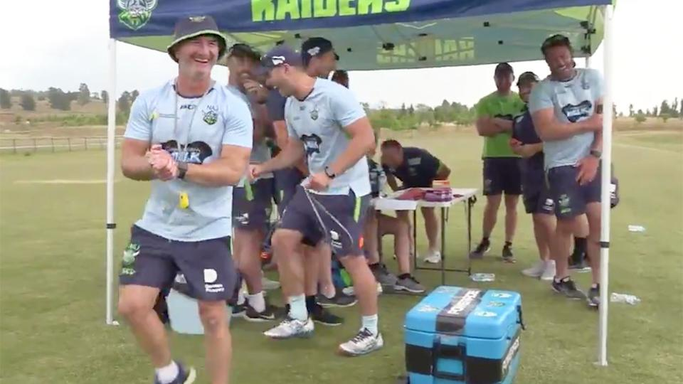 Raiders players and staff can be seen here laughing at the outcome of the snake prank.