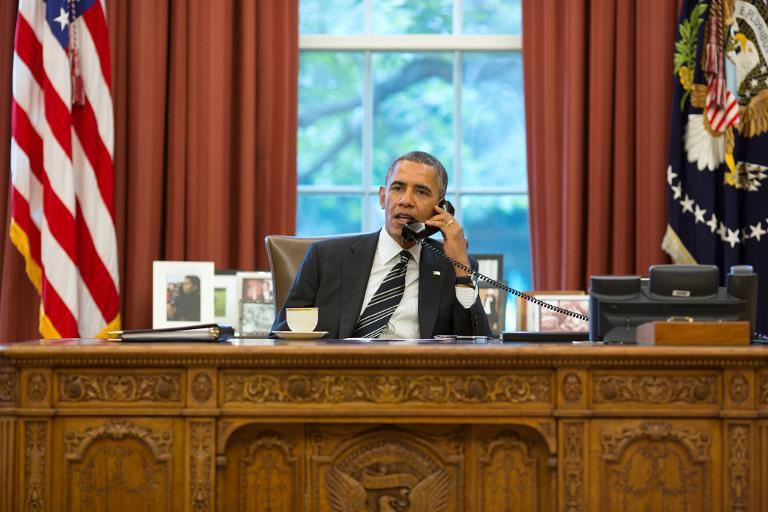 This official White House photograph released on September 27, 2013 shows President Barack Obama talks with President Hassan Rouhani of Iran during a phone call in the Oval Office