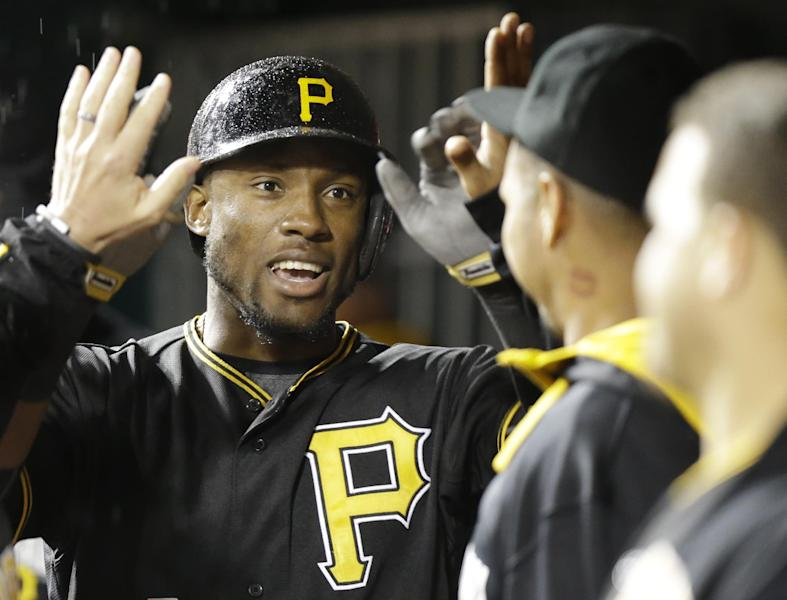 Pittsburgh Pirates' Starling Marte is congratulated after hitting a solo home run off Cincinnati Reds starting pitcher Homer Bailey in the fifth inning of a baseball game, Monday, April 14, 2014, in Cincinnati. (AP Photo/Al Behrman)