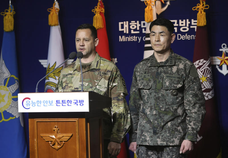 U.S. Army's Col. Lee Peters, director of Public Affairs of United States Forces Korea, and Col. Kim Jun-rak, of South Korea's Joint Chiefs of Staff brief about the their postponed joint militaries drills to the media at Defense Ministry in Seoul, South Korea, Thursday, Feb. 27, 2020. The South Korean and U.S. militaries have postponed their annual joint drills out of concerns over a virus outbreak. (Korea Pool/Yonhap via AP)