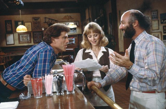 <i>Cheers</i> co-creator and director James Burrows (r) seen here going over a scene with stars Ted Danson (Sam Malone) and Shelley Long (Diane Chambers). (Photo: NBCUniversal)