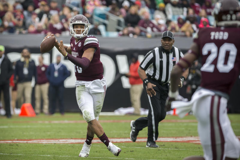 Mississippi State quarterback Keytaon Thompson (10) throws a pass during the first half of the TaxSlayer Bowl NCAA college football game against Louisville, Saturday, Dec. 30, 2017, in Jacksonville, Fla. (AP Photo/Stephen B. Morton)
