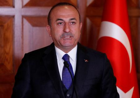 FILE PHOTO: Turkish Foreign Minister Mevlut Cavusoglu attends a news conference in Ankara