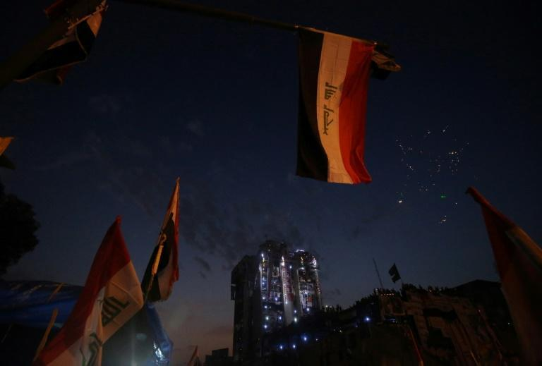 """Protesters have taken over an 18-storey building known as the """"Turkish restaurant"""", overlooking Baghdad's Tahrir Square"""