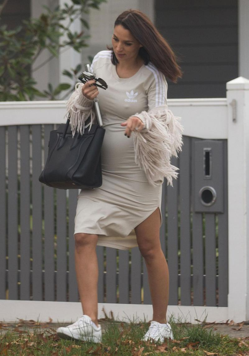 The reality star was glowing while doing the school run with 11-year-old daughter Eve in Melbourne on Tuesday, opting for a comfortable and casual outfit that revealed a hint of her growing belly. Source: Splash