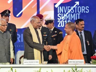 President Ram Nath Kovind shakes hands with UP Chief Minister Yogi Adityanath as Governor Ram Naik looks on, during the UP Investors Summit at Indira Gandhi Prathishthaan in Lucknow on Thursday. PTI