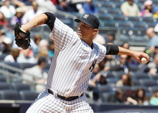 New York Yankees starting pitcher Andy Pettitte throws against the Oakland Athletics in the first inning of a baseball game in New York on Sunday, May 5, 2013. (AP Photo/Peter Morgan)