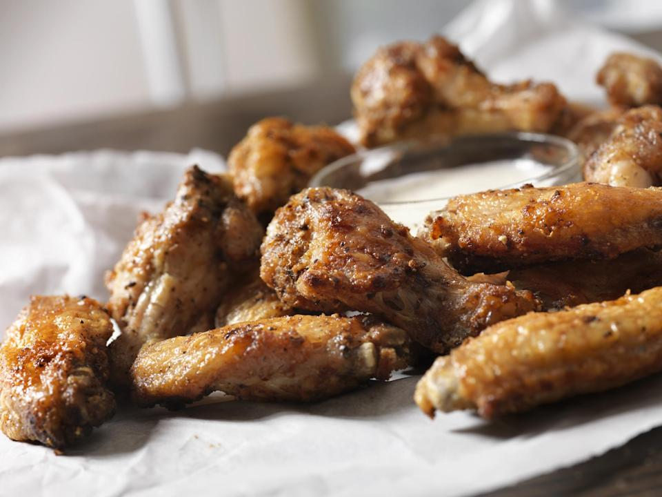 "<p>Chicken wings are a <a href=""https://www.thedailymeal.com/entertain/most-popular-super-bowl-party-foods-ranked-slideshow?referrer=yahoo&category=beauty_food&include_utm=1&utm_medium=referral&utm_source=yahoo&utm_campaign=feed"" rel=""nofollow noopener"" target=""_blank"" data-ylk=""slk:game day staple"" class=""link rapid-noclick-resp"">game day staple</a>, but that doesn't mean you can't make them at home whenever you feel like it. With a trendy air fryer, you can make chicken wings that are crispy and tender without all that frying grease. This recipe is easy and requires only a few basic ingredients: chicken wings, salt and pepper, garlic powder, olive oil and your favorite wing sauce.</p> <p><a href=""https://www.thedailymeal.com/cook/air-fryer-chicken-wings?referrer=yahoo&category=beauty_food&include_utm=1&utm_medium=referral&utm_source=yahoo&utm_campaign=feed"" rel=""nofollow noopener"" target=""_blank"" data-ylk=""slk:For the Air-Fryer Chicken Wings recipe, click here."" class=""link rapid-noclick-resp"">For the Air-Fryer Chicken Wings recipe, click here. </a></p>"
