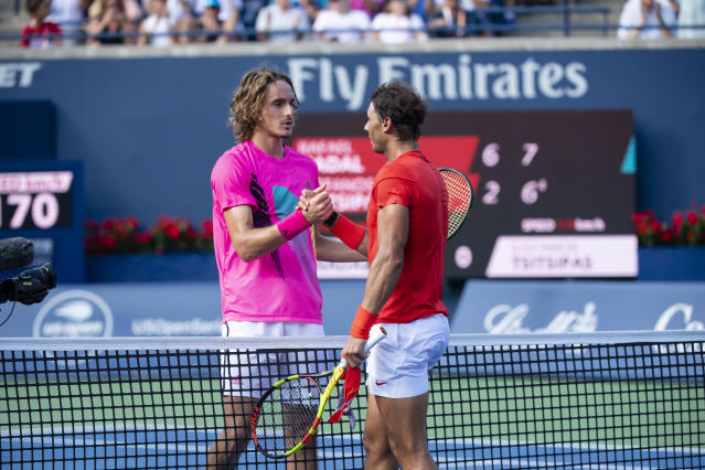 Rafael Nadal and Stefanos Tsitsipas embrace at the net after their Rogers Cup final