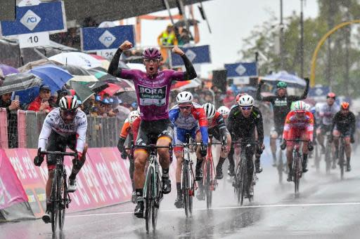 Germany's Pascal Ackermann celebrates as he sprints ahead of Colombia's Fernando Gaviria, left, to win the fifth stage of the Giro D'Italia, tour of Italy cycling race, from Frascati to Terracina, Wednesday, May 15, 2019. Pascal Ackermann of Germany sprinted to victory at the end of the rain-affected fifth stage of the Giro d'Italia as Slovenian cyclist Primoz Roglic remained overall leader. (Alessandro Di Meo/ANSA via AP)