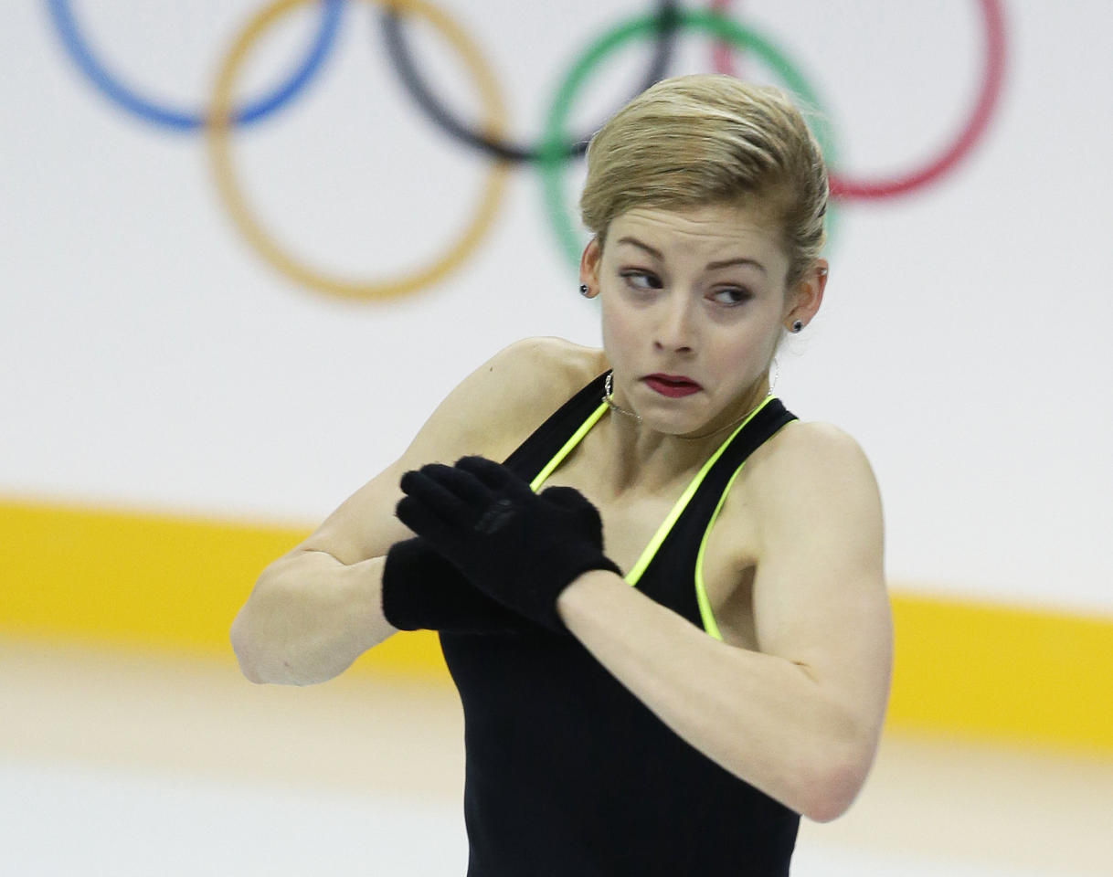 Gracie Gold of the United States skates during a practice session at the figure stating practice rink at the 2014 Winter Olympics, Tuesday, Feb. 18, 2014, in Sochi, Russia. (AP Photo/Darron Cummings)