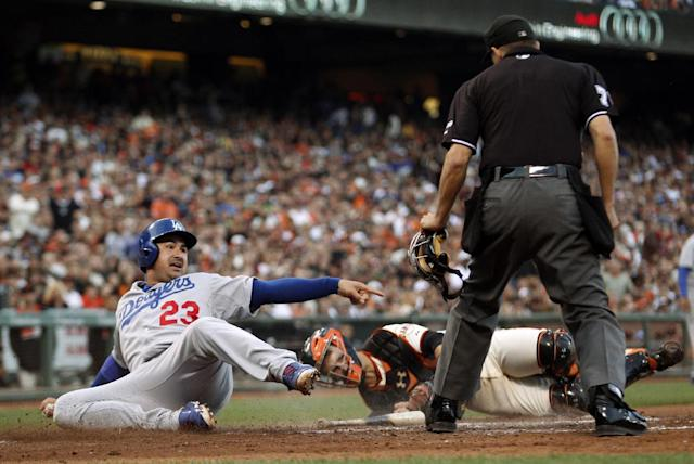 Los Angeles Dodgers' Adrian Gonzalez (23) pleads with home plate umpire Adam Hamari, right, after being tagged out by San Francisco Giants catcher Buster Posey, center, during the sixth inning of a baseball game on Saturday, July 26, 2014, in San Francisco. (AP Photo/Beck Diefenbach)