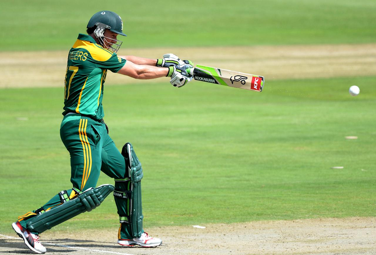 CENTURION, SOUTH AFRICA - DECEMBER 11: AB de Villiers of South Africa hits a delivery to the boundary during the 3rd Momentum ODI match between South Africa and India at SuperSport Park on December 11, 2013 in Centurion, South Africa. (Photo by Duif du Toit/Gallo Images/Getty Images)