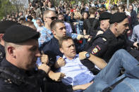 FILE - In this May 5, 2018, file photo, Russian police carry opposition leader Alexei Navalny, center, from a demonstration against President Vladimir Putin in Pushkin Square in Moscow, Russia. Navalny is an anti-corruption campaigner and the Kremlin's fiercest critic. Frequently arrested, he has served multiple stints in jail for charges relating to leading protests. (AP Photo/File)