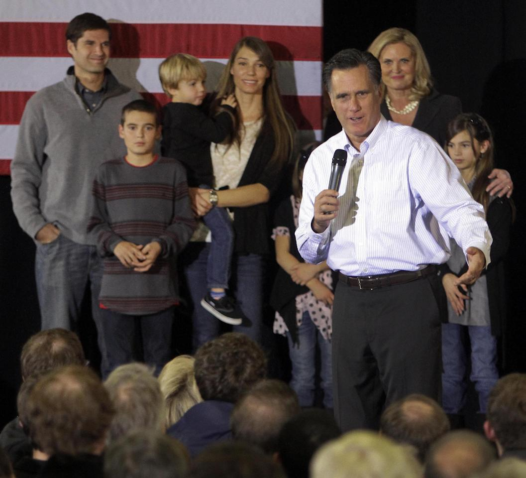 With some of his family behind him, Republican presidential candidate, former Massachusetts Gov. Mitt Romney speaks during a campaign stop, Monday, Jan. 9, 2012, in Bedford, N.H. (AP Photo/Jim Cole)