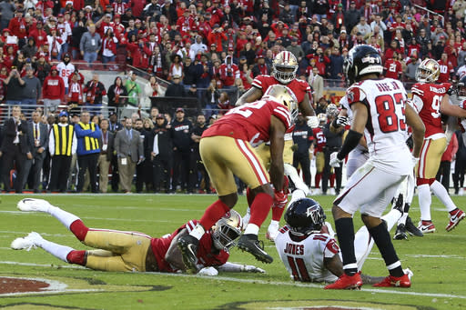 Atlanta Falcons wide receiver Julio Jones (11) sits next to the goal line after scoring against the San Francisco 49ers during the second half of an NFL football game in Santa Clara, Calif., Sunday, Dec. 15, 2019. (AP Photo/John Hefti)