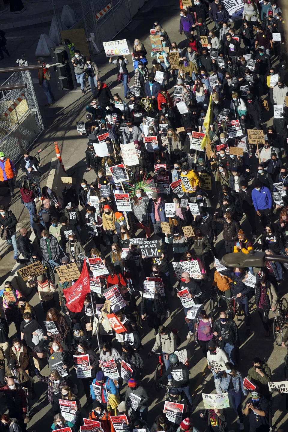 Hundreds of demonstrators march through Minneapolis following protests near the Hennepin County Government Center, Monday, March 8, 2021, in Minneapolis where the trial for former Minneapolis police officer Derek Chauvin began with jury selection. Chauvin is charged with murder in the death of George Floyd during an arrest last May in Minneapolis. (AP Photo/Jim Mone)