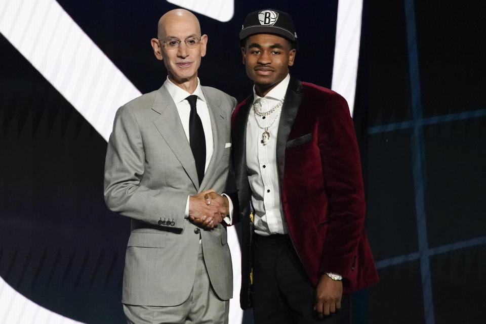 Cameron Thomas, right, poses for a photo with NBA Commissioner Adam Silver after being selected 27th overall by the Brooklyn Nets during the NBA basketball draft, Thursday, July 29, 2021, in New York. - Credit: AP