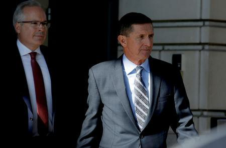 FILE PHOTO: Former U.S. National Security Adviser Michael Flynn departs after a plea hearing at U.S. District Court, in Washington, U.S., December 1, 2017.   REUTERS/Joshua Roberts/File Photo
