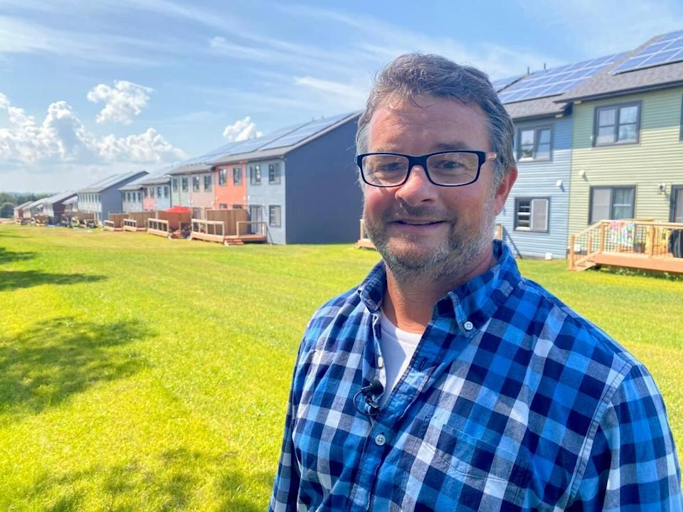 Josh Silver, a carpenter and instructor at Holland College in Charlottetown, says solar panels have become an affordable choice for new builds on P.E.I.   (Jane Robertson/CBC - image credit)