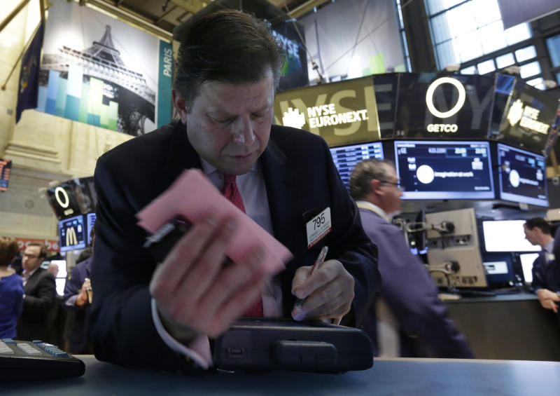 FILE - In this  Friday, March 1, 2013 file photo, Trader Edward Schreier works on the floor of the New York Stock Exchange. World stock markets edged off recent highs in uneven trading Tuesday March 12, 2013 as worries grew about China's recovery and Europe's doldrums. (AP Photo/Richard Drew)