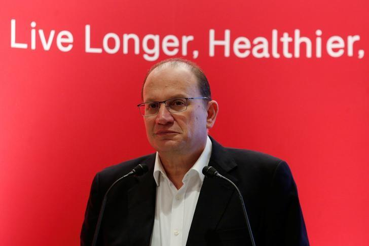 AIA Group Chief Executive and President Mark Tucker attends a news conference in Hong Kong
